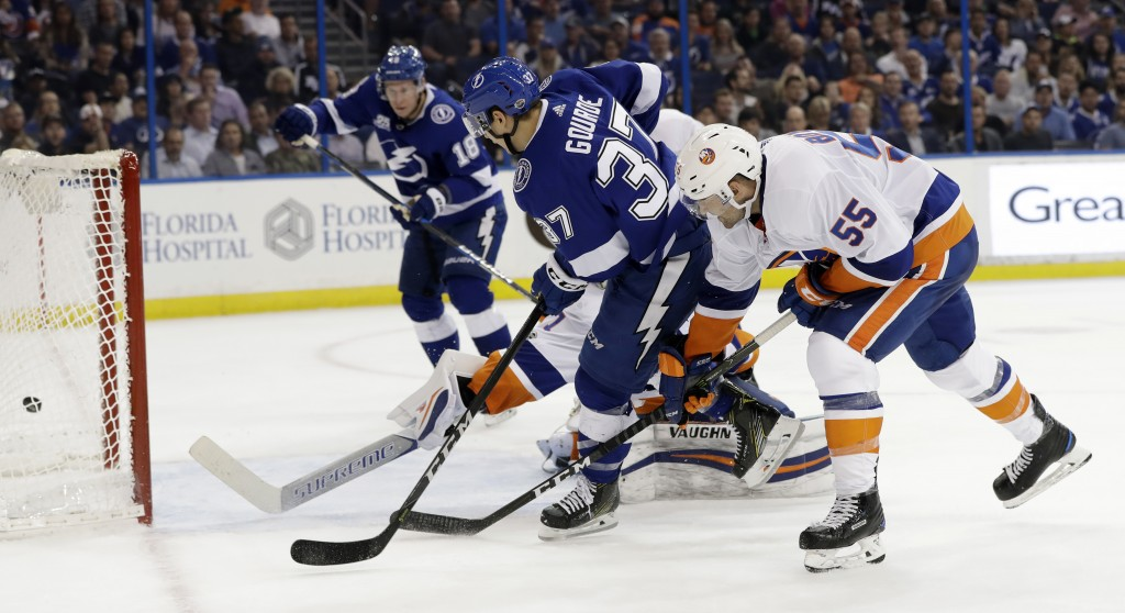 Tampa Bay Lightning center Yanni Gourde (37) fires the puck into the net for a goal against the New York Islanders during the second period of an NHL
