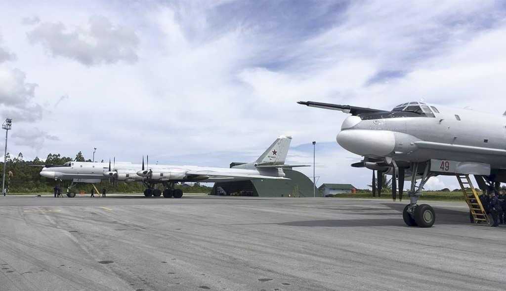 In this photo released by Russian Defense Ministry official web site Tuesday, Dec. 5, 2017 shows Russian Tu-95 bombers arrive on Biak Island in Indone