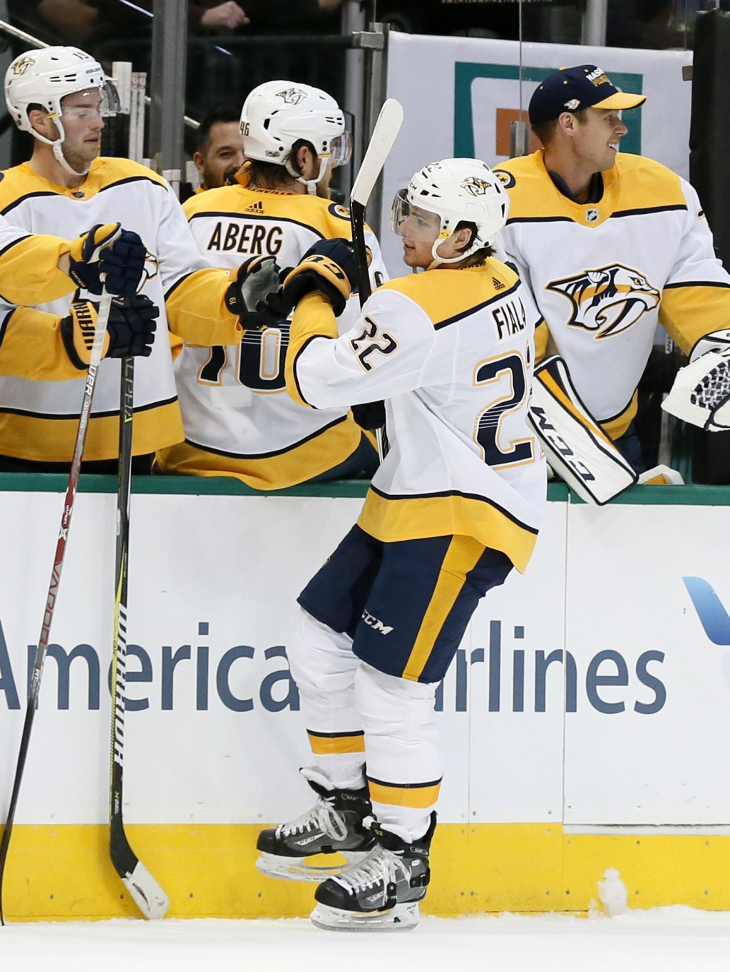 Nashville Predators left wing Kevin Fiala (22) is congratulated by teammates  on the bench after scoring against the Dallas Stars during the first per