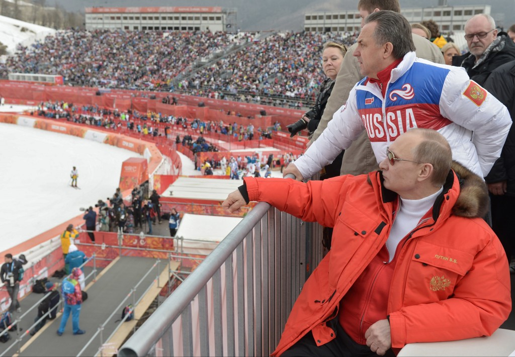 FILE - In this file photo taken Saturday, March 8, 2014, Russian President Vladimir Putin, foreground, watches downhill ski competition of the 2014 Wi
