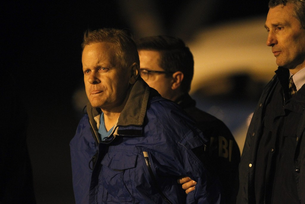Fugitive lawyer Eric Conn is taken into custody by FBI agents on the tarmac at Blue Grass Airport in Lexington, Ky., Tuesday, Dec. 5, 2017. Conn, who