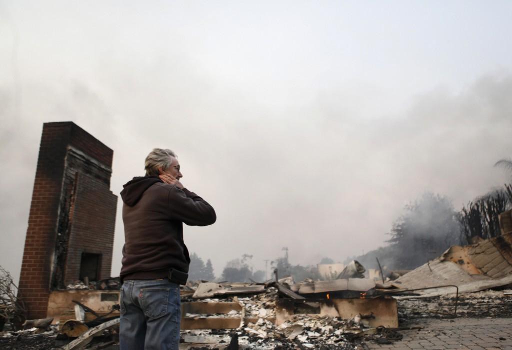 Greg Smith stands amid the ruins of his home after the Thomas fire swept through Ventura, Calif., Tuesday, Dec. 5, 2017. (Daniel Dreifuss via AP)