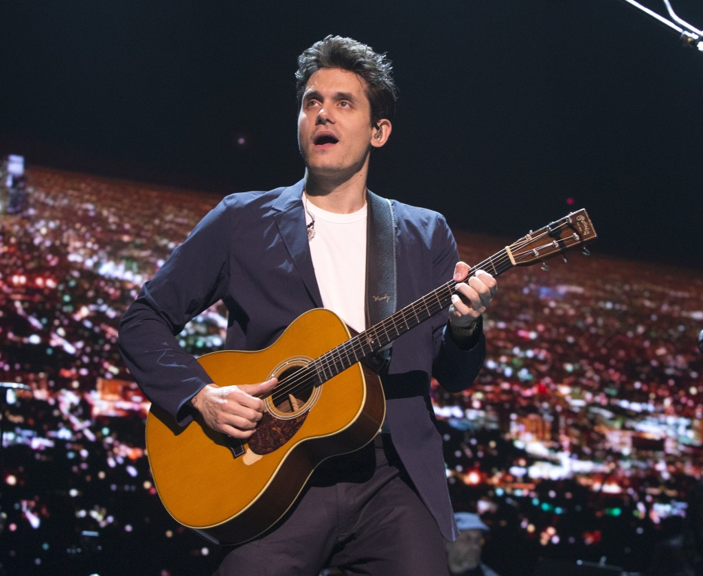 "FILe - In this April 7, 2017 file photo, John Mayer performs in concert during his ""The Search for Everything Tour"" in Philadelphia. Mayer has been ho"