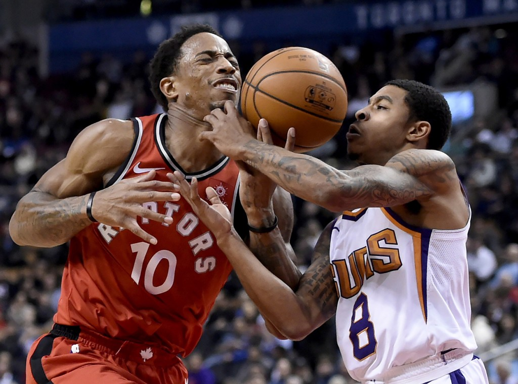 Toronto Raptors guard DeMar DeRozan (10) tries to drive to the net as Phoenix Suns guard Tyler Ulis (8) defends during the second half of an NBA baske