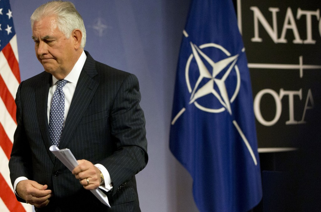 U.S. Secretary of State Rex Tillerson walks off the podium after addressing a media conference at NATO headquarters in Brussels on Wednesday, Dec. 6,