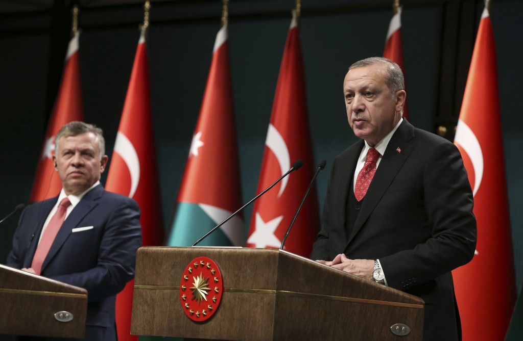 Turkey's President Recep Tayyip Erdogan, right, talks during a joint news conference with Jordan's King Abdullah II, left, following their meeting at