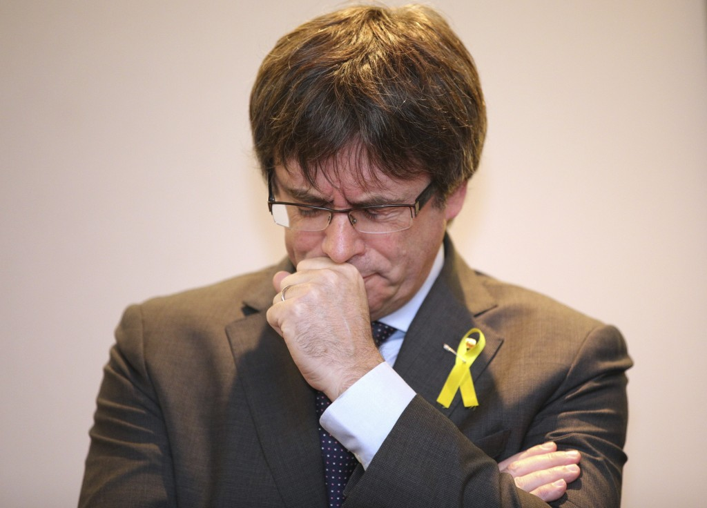 Ousted Catalan leader Carles Puigdemont pauses before speaking during a media conference in Brussels on Wednesday, Dec. 6, 2017. Catalan secessionist