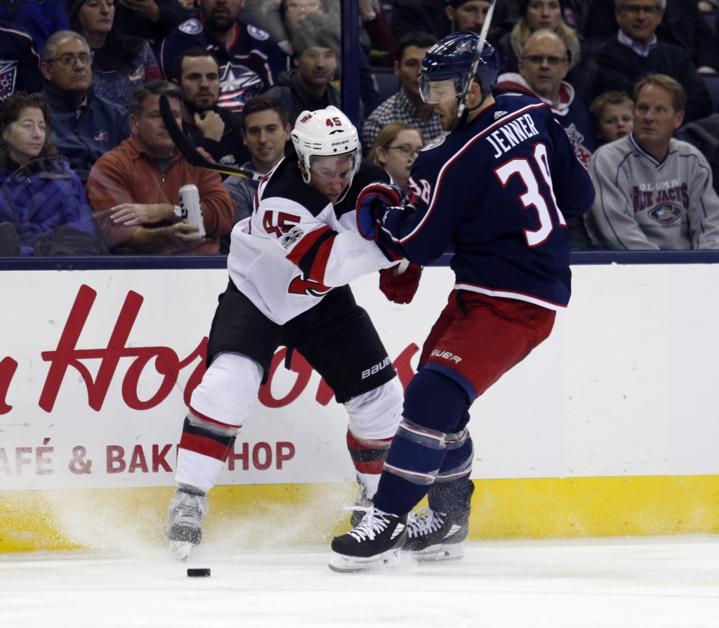New Jersey Devils defenseman Sami Vatanen, left, of Finland, works against Columbus Blue Jackets forward Boone Jenner during the second period of an N