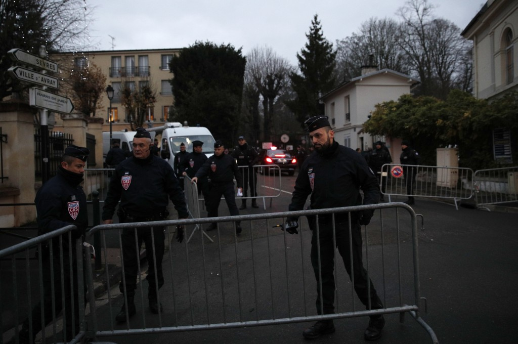 French riot police officers cordon off the area around Johnny Hallyday's house in Marnes-la-Coquette, outside Paris, Wednesday, Dec.6, 2017. Johnny Ha
