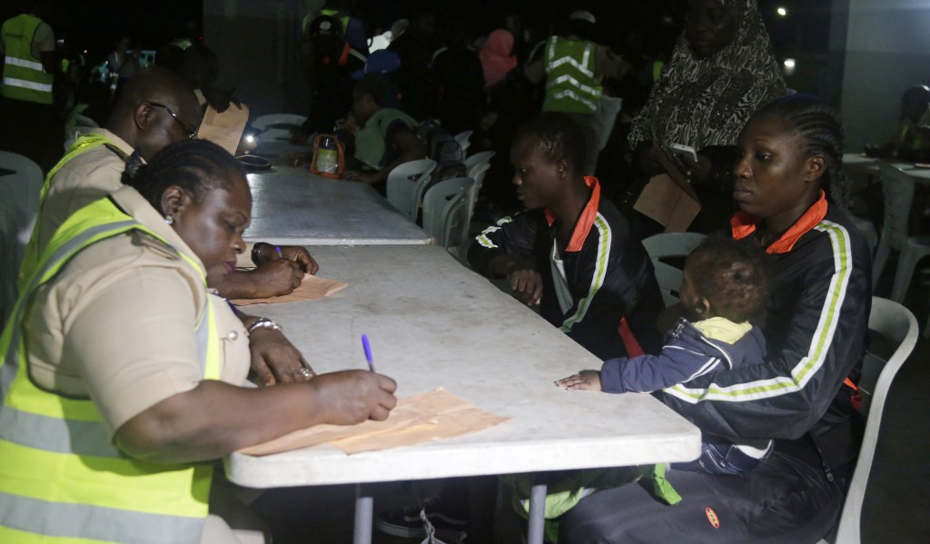 Nigeria Immigration officials register Nigerian returnees upon arrival at the Murtala Muhammed International Airport in Lagos Nigeria Tuesday, Dec. 5,