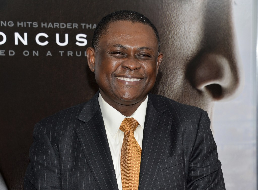 """FILE - In this Dec. 16, 2015 file photo, Dr. Bennet Omalu attends a special screening of """"Concussion"""" in New York. Omalu, a pathologist best known for"""