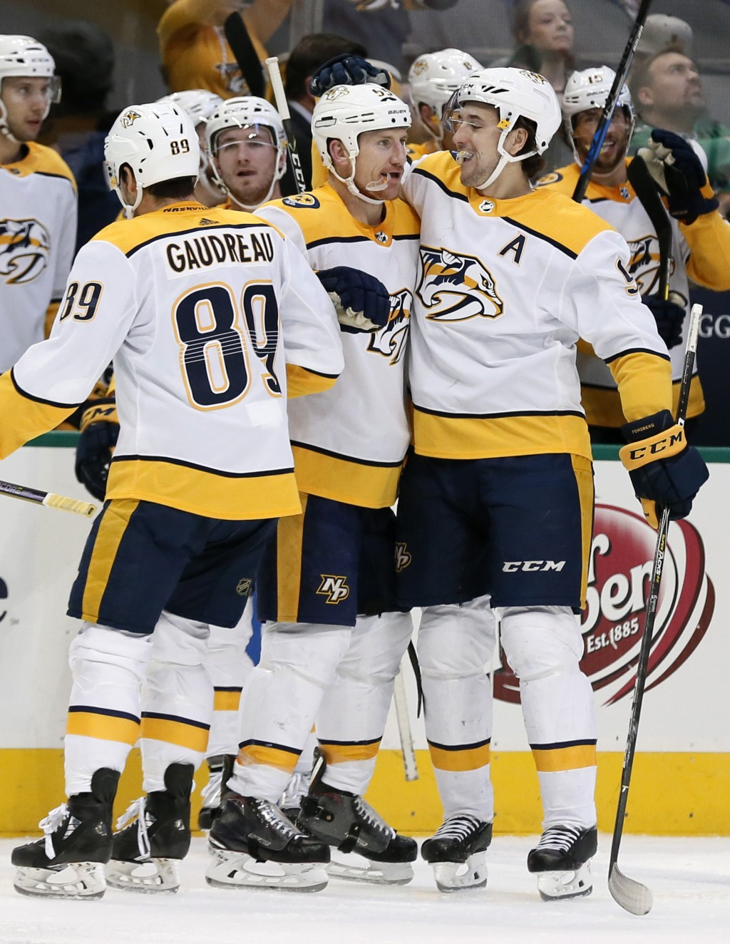 Nashville Predators' Frederick Gaudreau (89), Cody McLeod (55) and Filip Forsberg, right, celebrate a goal by McLeod during the second period of an NH