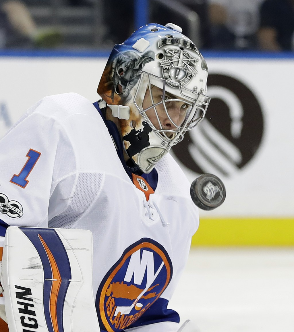 New York Islanders goalie Thomas Greiss (1) makes a save on a shot by the Tampa Bay Lightning during the second period of an NHL hockey game Tuesday,