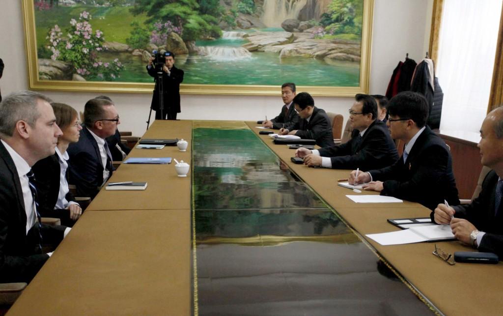 U.N. Undersecretary-General for Political Affairs Jeffrey Feltman, third left, talks with North Korean Vice Foreign Minister Pak Myong Guk, third righ