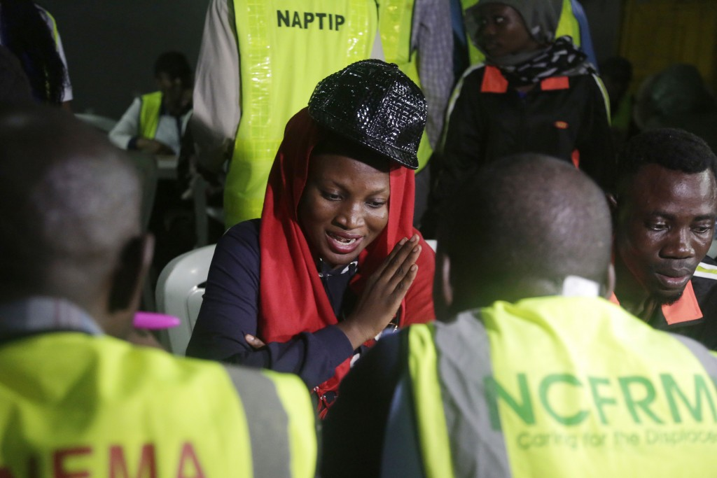 National Emergency Management Agency officials register Nigerian returnees from Libya upon arrival at the Murtala Muhammed International Airport in La