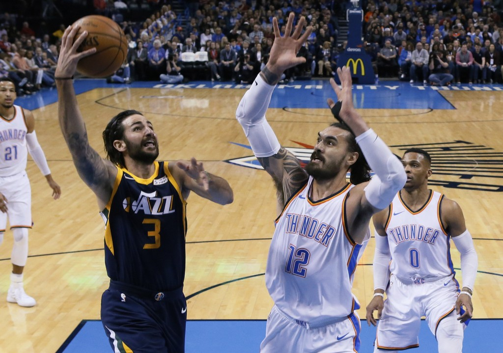 Utah Jazz guard Ricky Rubio (3) shoots in front of Oklahoma City Thunder center Steven Adams (12) in the first quarter of an NBA basketball game in Ok