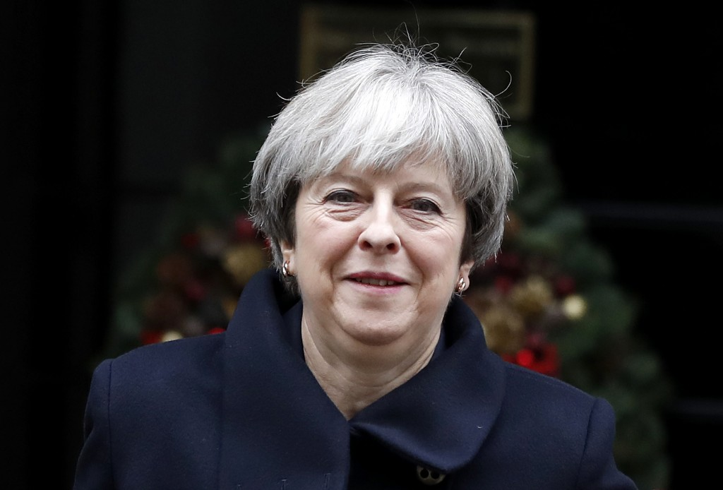 Britain's Prime Minister Theresa May leaves 10 Downing Street to attend the weekly session of Prime Ministers Questions in Parliament in London, Wedne