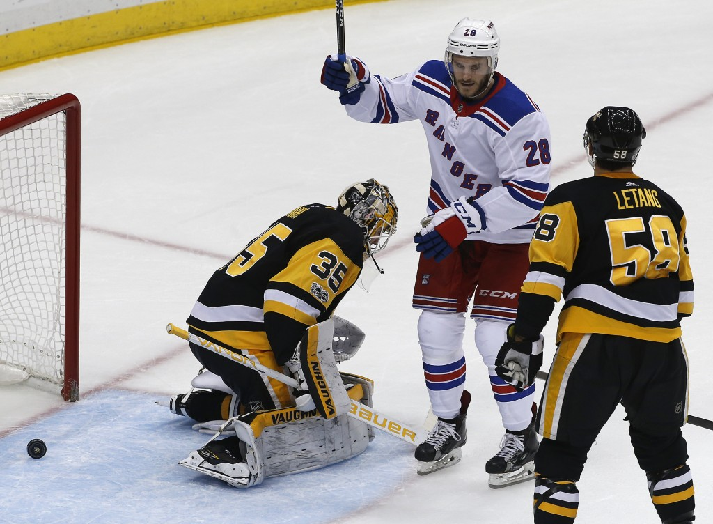 New York Rangers' Paul Carey (28) begins to celebrate after a shot by Rangers' Boo Nieves got behind Pittsburgh Penguins goalie Tristan Jarry (35) for