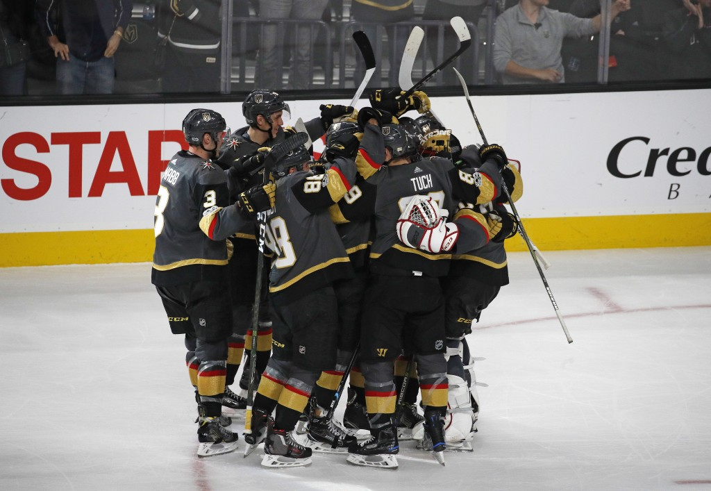 Vegas Golden Knights celebrate after defeating the Anaheim Ducks in a shootout in an NHL hockey game Tuesday, Dec. 5, 2017, in Las Vegas. The Knights