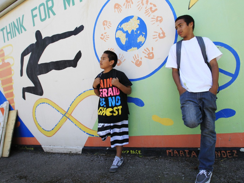 FILE - In this May 10, 2011, file photo, Van Buren Elementary school seventh grade students Daniel Mayen, left, and Victor Gonzalez, right, take a bre
