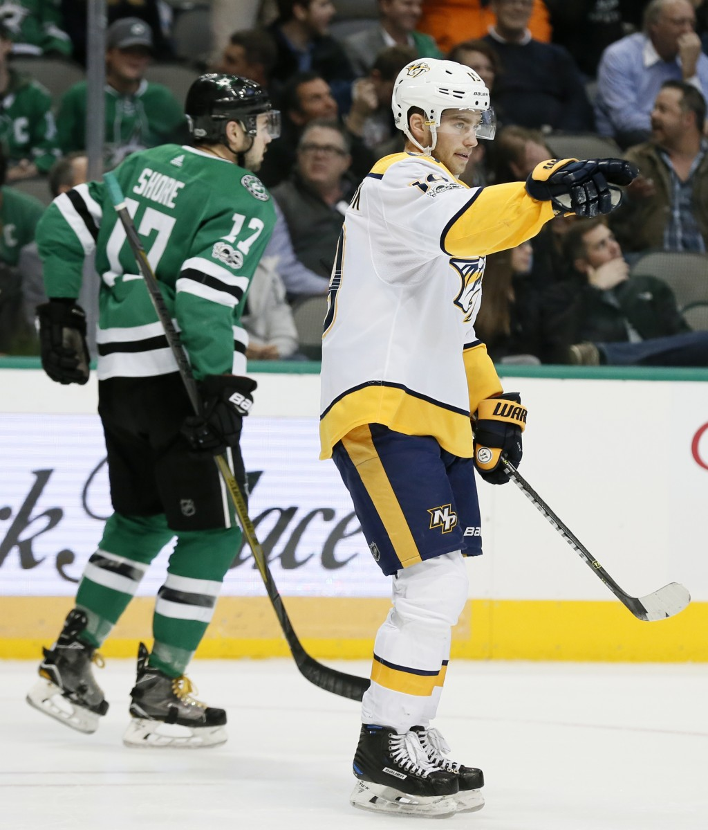 Nashville Predators center Calle Jarnkrok (19) celebrates his goal as Dallas Stars' Devin Shore (17) skates away during the second period of an NHL ho