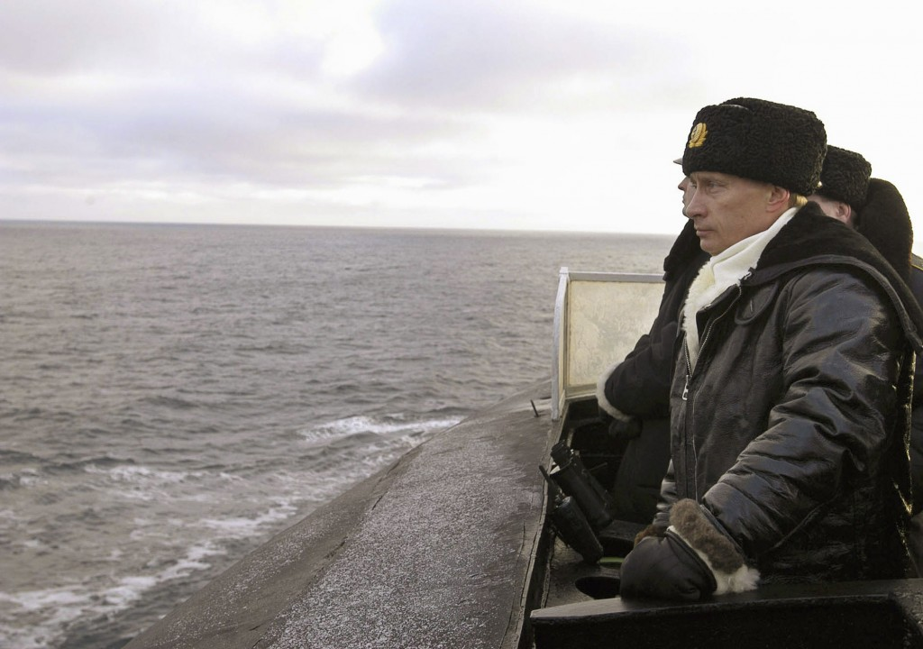 FILE- In this file photo taken on Tuesday, Feb. 17, 2004, Russian President Vladimir Putin is seen aboard the Arkhangelsk nuclear submarine in the Bar