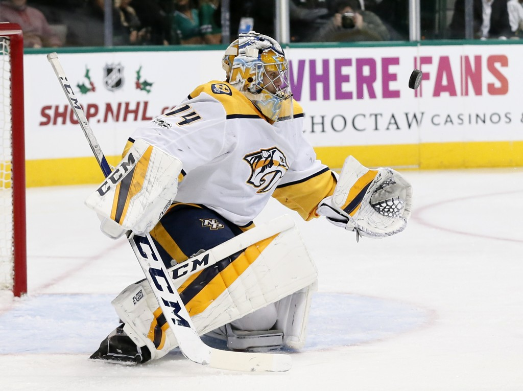 Nashville Predators goalie Juuse Saros watches a shot from the Dallas Stars during the first period of an NHL hockey game, Tuesday, Dec. 5, 2017, in D