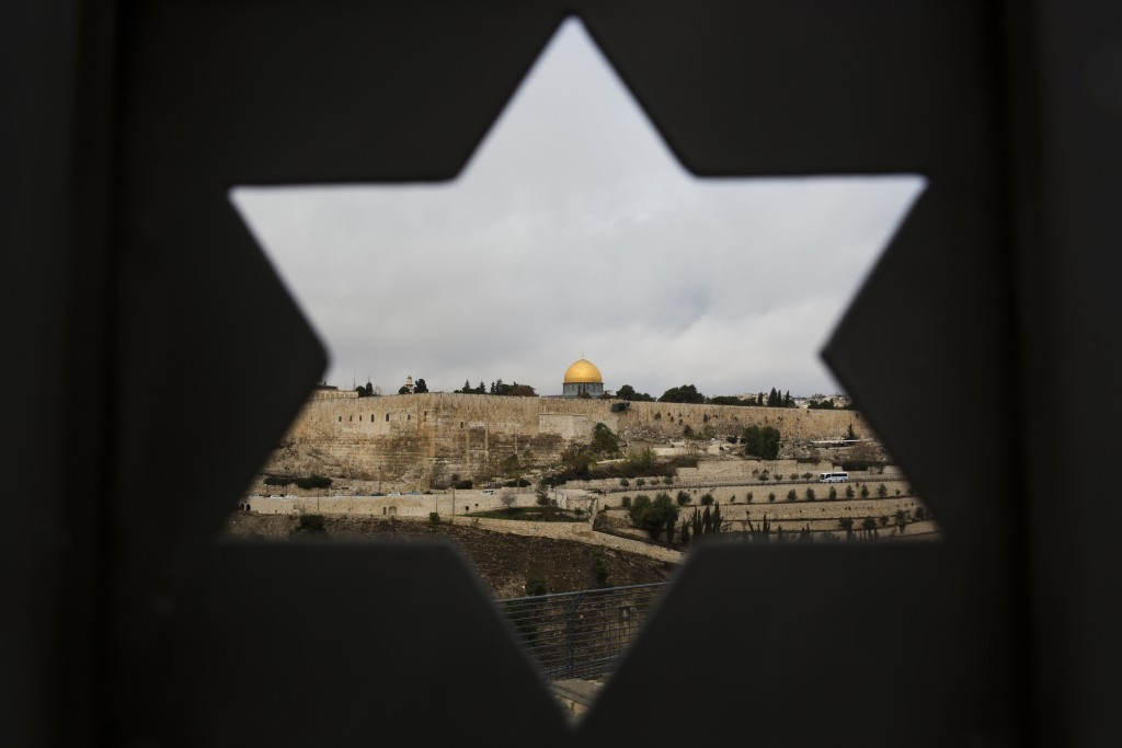 Jerusalem Old City is seen trough a door with the shape of star of David, in Jerusalem, Wednesday, Dec. 6, 2017. U.S. officials say President Donald T