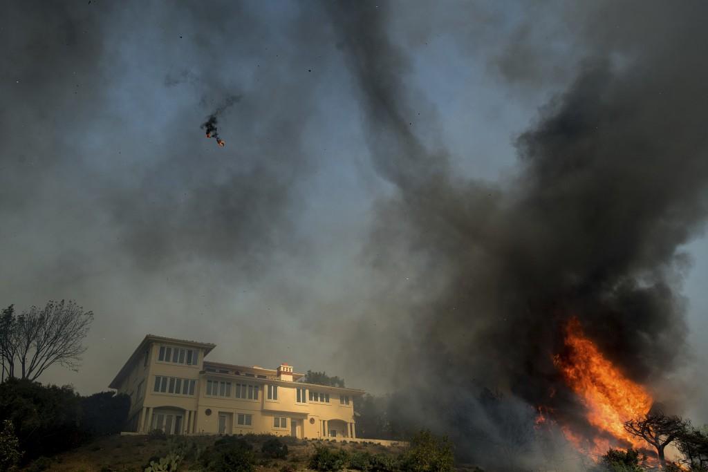A burning ember flies through the air as winds fan a wildfire in Ventura, Calif., on Tuesday, Dec. 5, 2017. (AP Photo/Noah Berger)