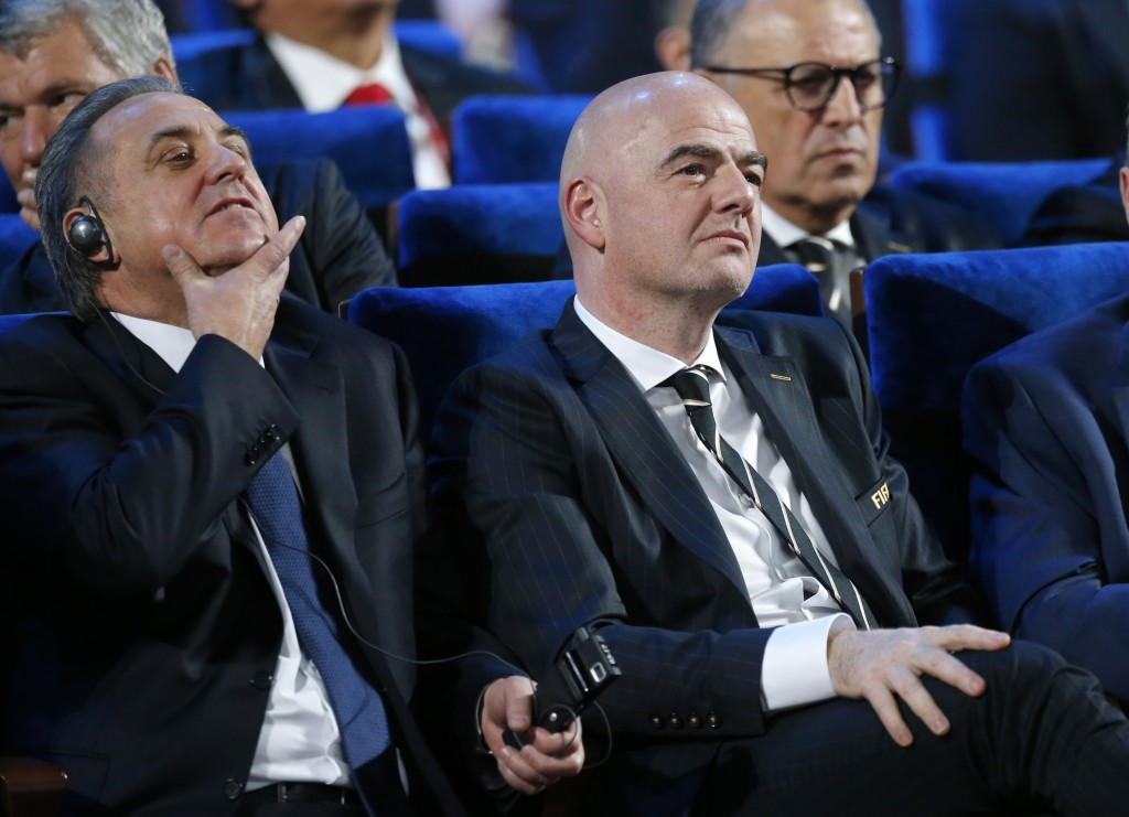 FILE - In this Dec. 1, 2017 file photo FIFA president Gianni Infantino, right, and Vitaly Mutko, Russian Federation Deputy Prime Minister & Local Orga