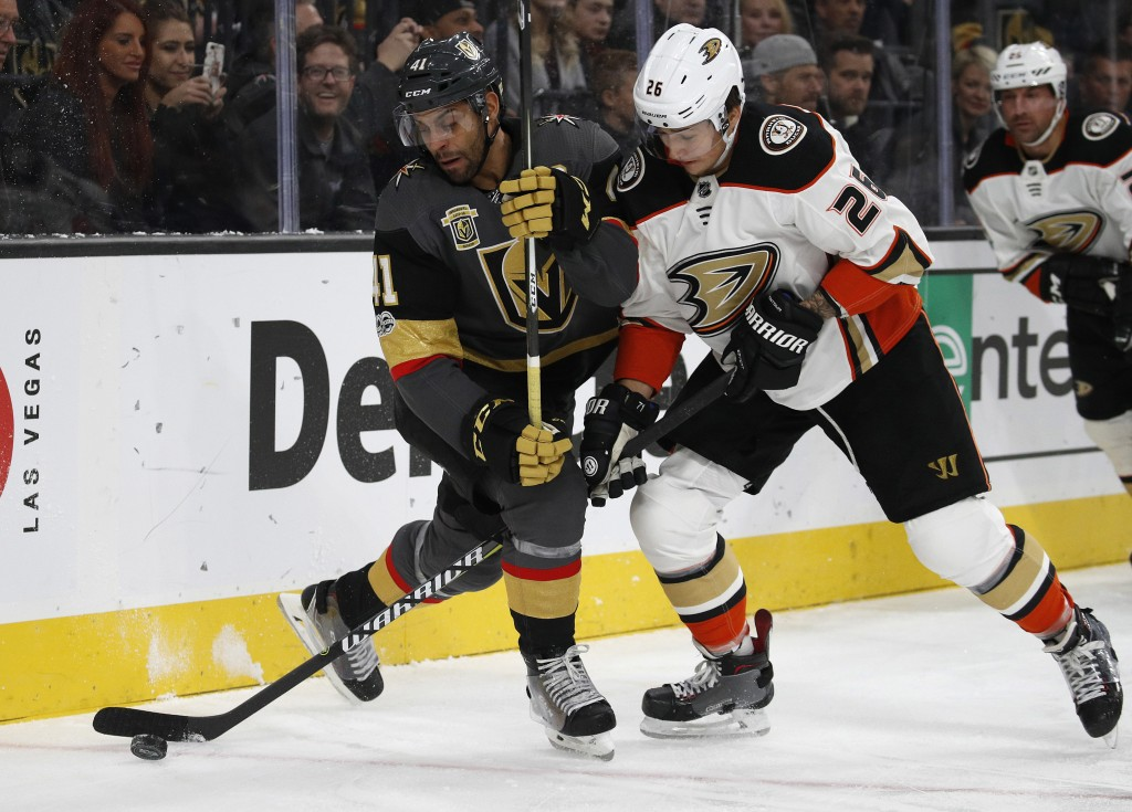 Vegas Golden Knights left wing Pierre-Edouard Bellemare, left, and Anaheim Ducks defenseman Brandon Montour battle for the puck during the first perio