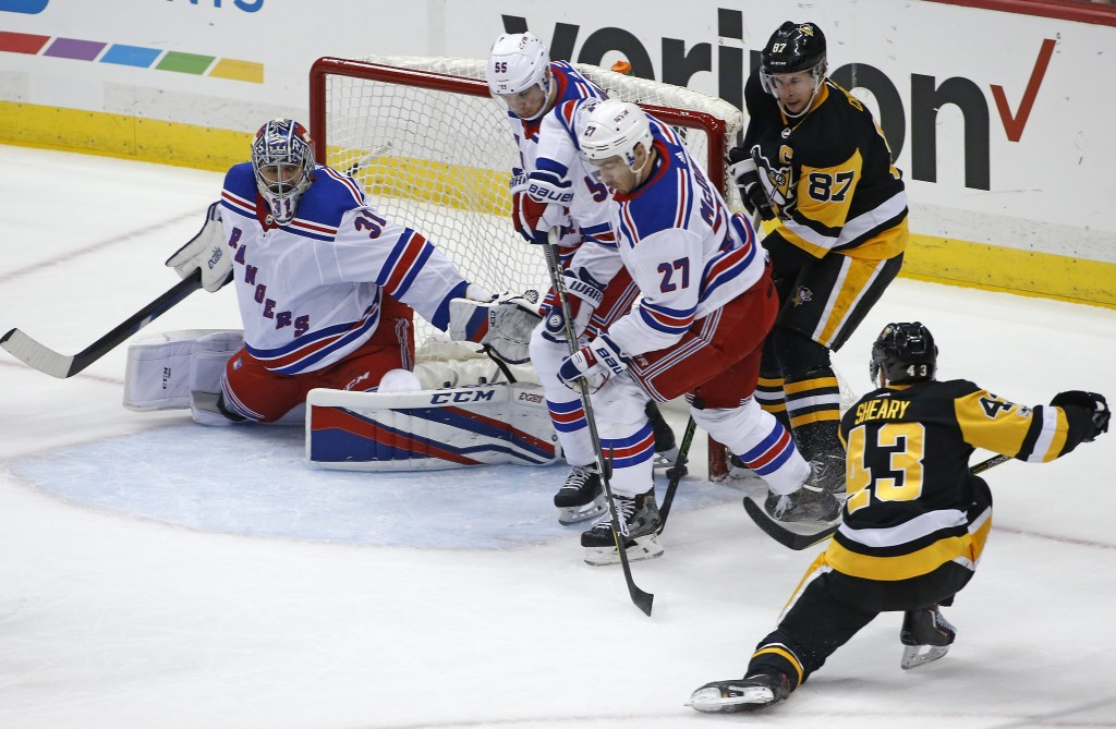 Pittsburgh Penguins' Conor Sheary (43) gets a shot past New York Rangers goalie Ondrej Pavelec (31) and defenders Nick Holden (55) and Ryan McDonagh (