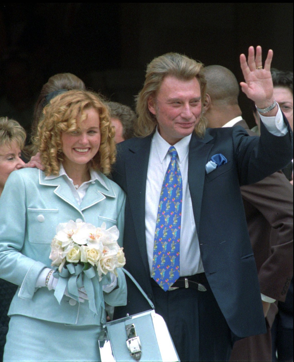 FILE - In this March 25 1996 file photo, French rock star Johnny Hallyday, 53, right, and Laeticia Boudou, 19, leave the Paris suburb, Neuilly-Sur-Sei