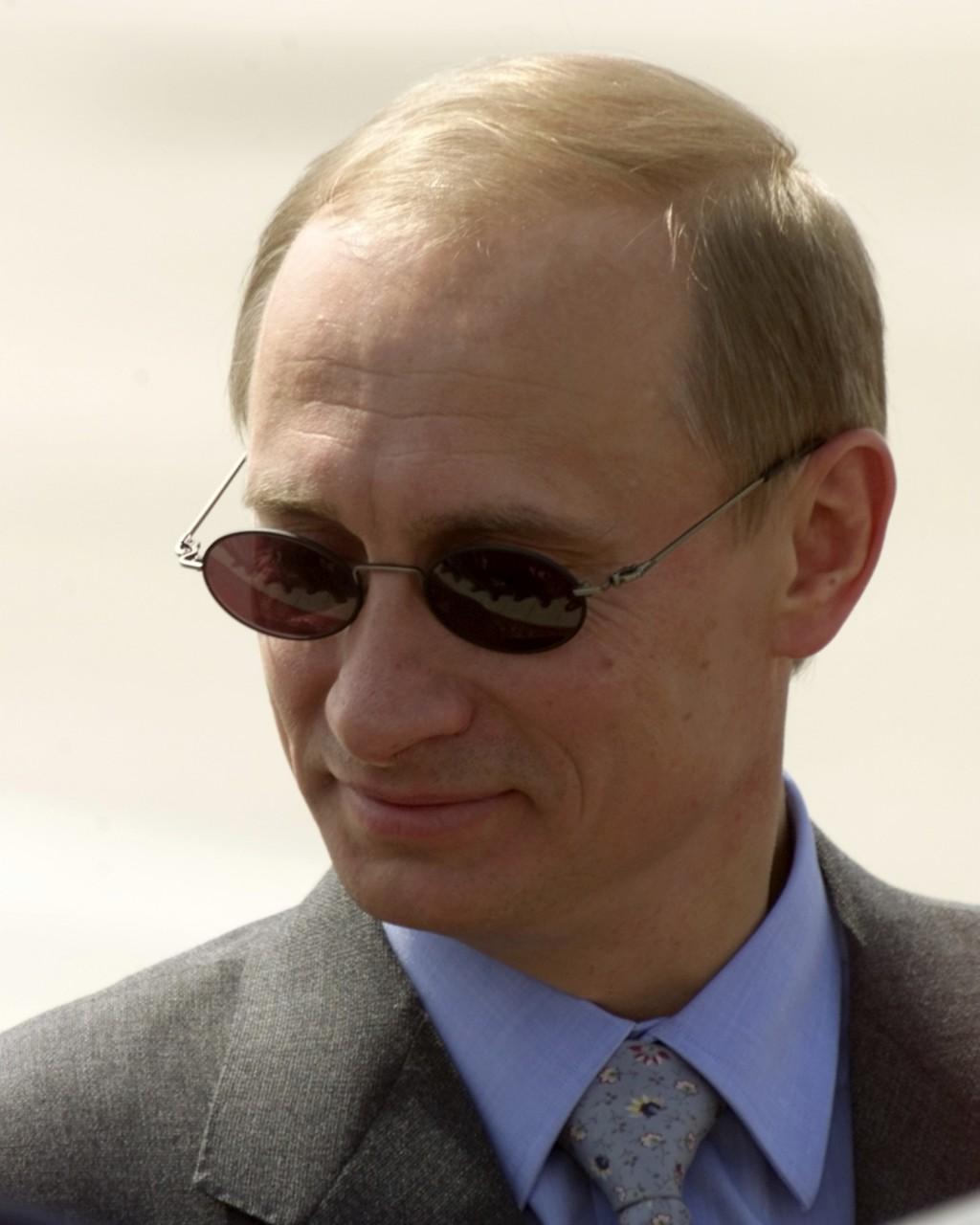 FILE -In this file photo taken on Friday, May 19, 2000, Russian President Vladimir Putin smiles during his visit in Ashgabat, Turkmenistan. Putin on W
