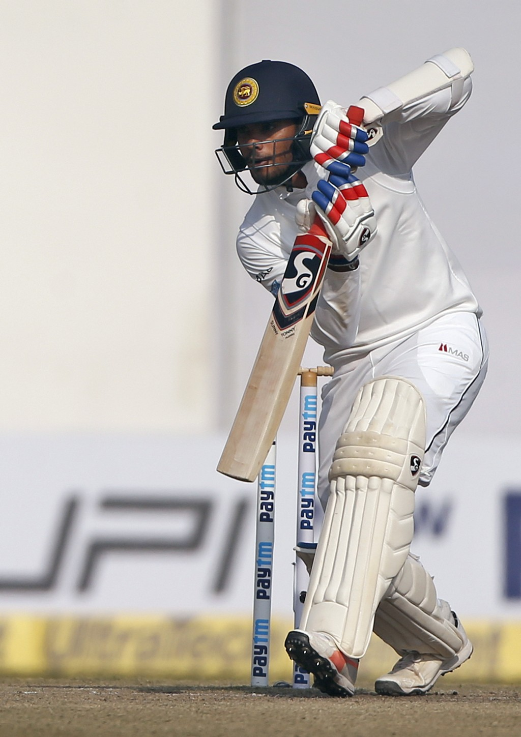 Sri Lanka's Dhananjaya De Silva bats during the fifth day of their third test cricket match against India in New Delhi, India, Wednesday, Dec. 6, 2017