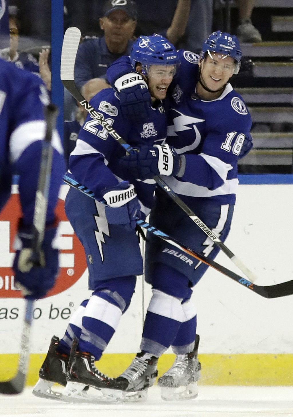 Tampa Bay Lightning center Brayden Point (21) celebrates his goal against the New York Islanders with left wing Ondrej Palat (18) during the first per