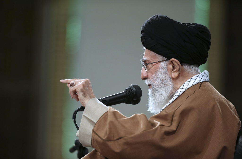 In this photo released by an official website of the office of the Iranian supreme leader, Supreme Leader Ayatollah Ali Khamenei speaks with Iranian o