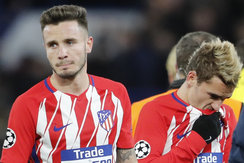 Atletico's Saul Niguez, left, and Antoine Griezmann react to the 1-1 draw after the Champions League Group C soccer match between Chelsea and Atletico