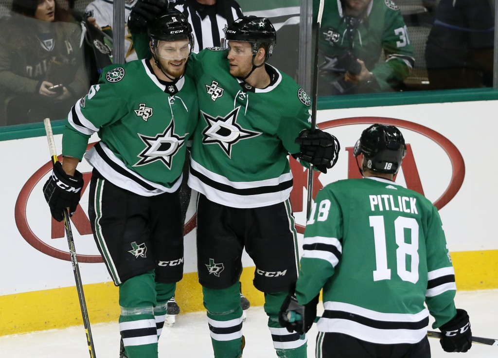 Dallas Stars defenseman Jamie Oleksiak (5), Radek Faksa (12) and Tyler Pitlick (18) celebrate a goal scored by Oleksiak during the third period of an