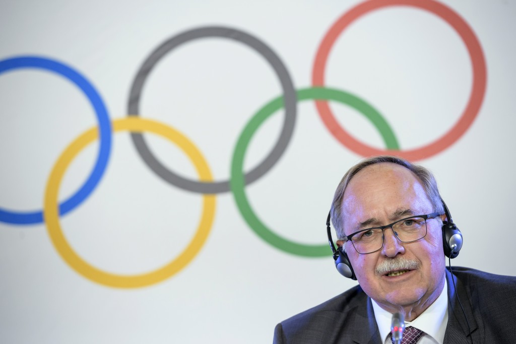 Samuel Schmid, President of the IOC Inquiry Commission and former President of Switzerland, reacts during a media conference after an Executive Board