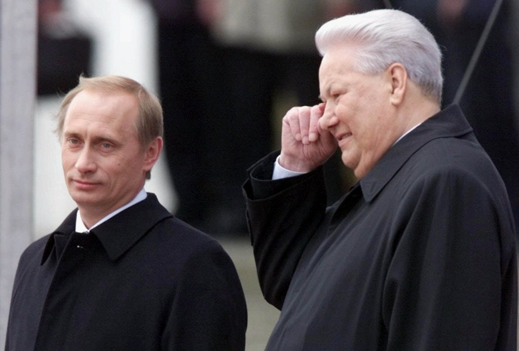 FILE - In this file photo taken on Sunday, May 7, 2000, Russian President Vladimir Putin, left, and former President Boris Yeltsin watch Kremlin guard