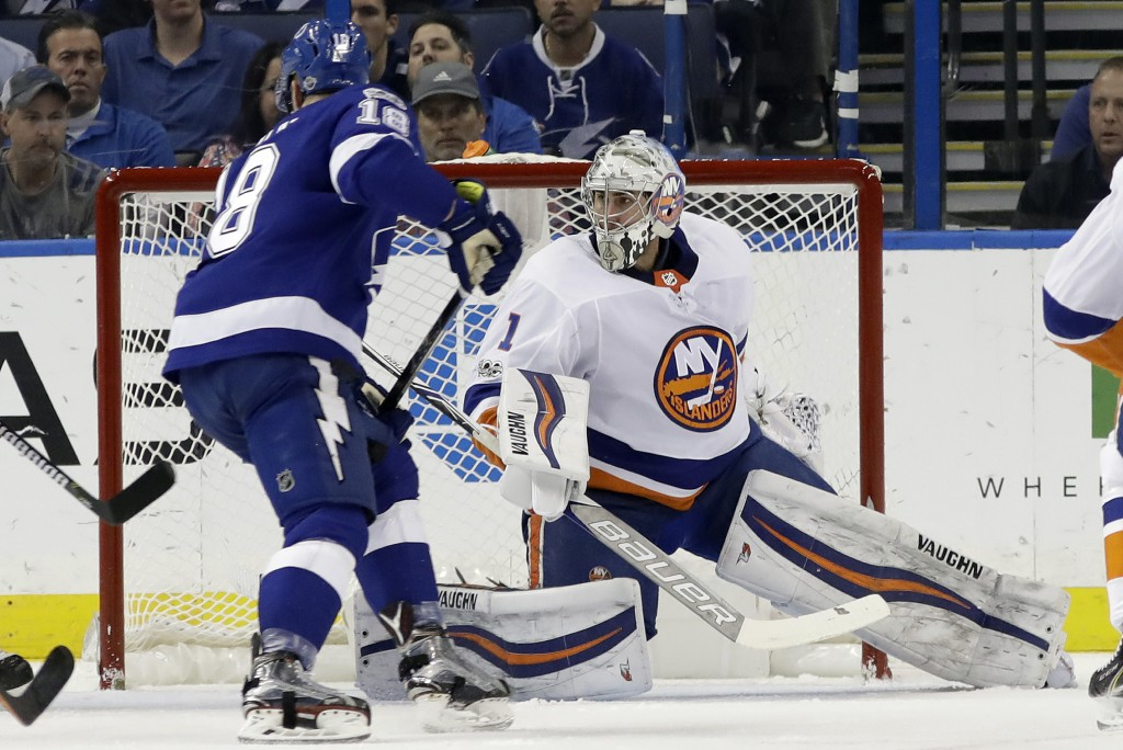 New York Islanders goalie Thomas Greiss (1) makes a save on a shot by Tampa Bay Lightning left wing Ondrej Palat (18) during the first period of an NH