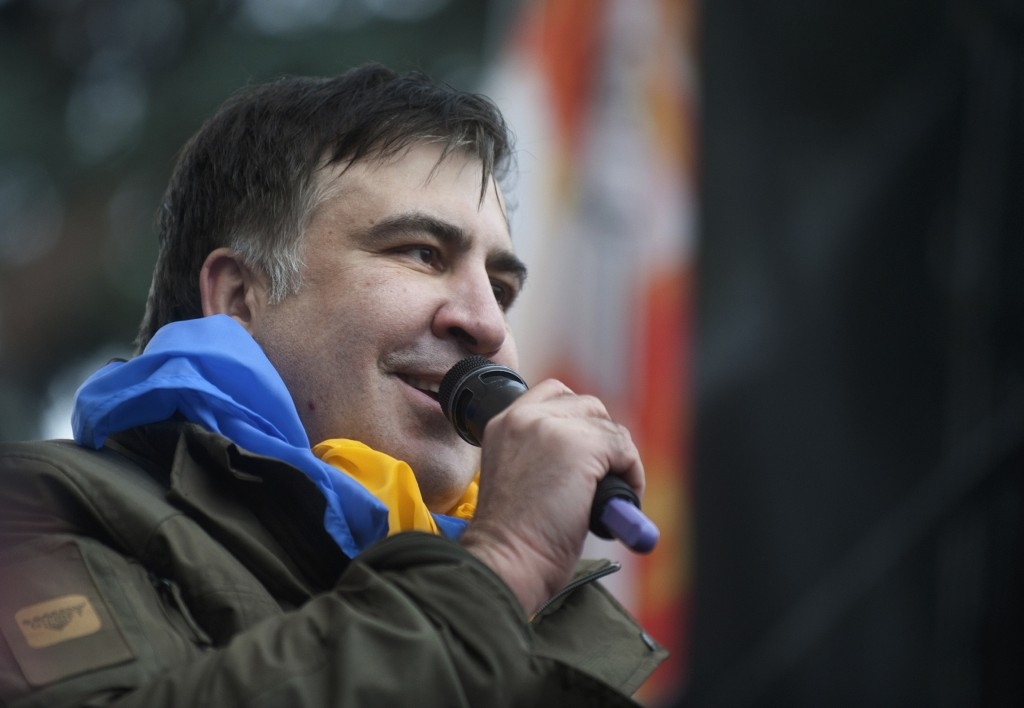 Former Georgian president Mikheil Saakashvili addresses protesters after he escaped with help from supporters and led them on a march toward parliamen
