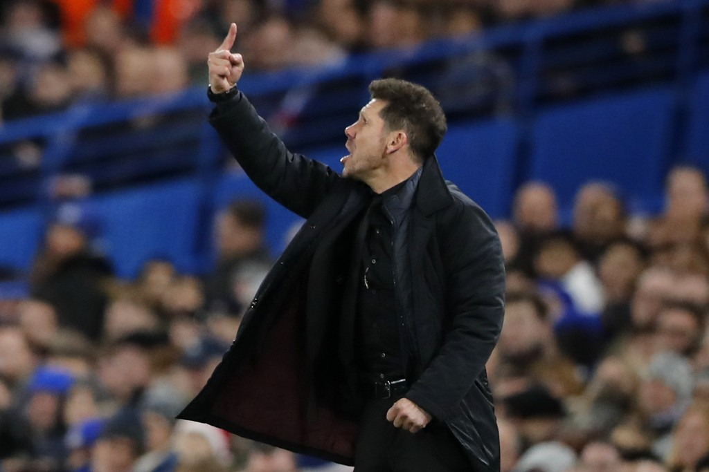 Atletico coach Diego Simeone gives directions during the Champions League Group C soccer match between Chelsea and Atletico Madrid at Stamford Bridge