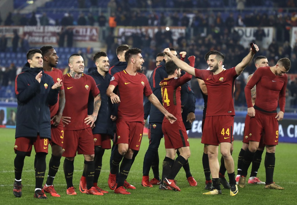 Roma players celebrate their victory at the end of the group C Champions League soccer match between Roma and Qarabag at the Stadio Olimpico in Rome,
