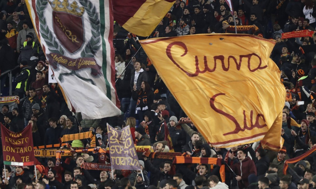 Roma supporters celebrate their team's victory at the end of the group C Champions League soccer match between Roma and Qarabag at the Stadio Olimpico