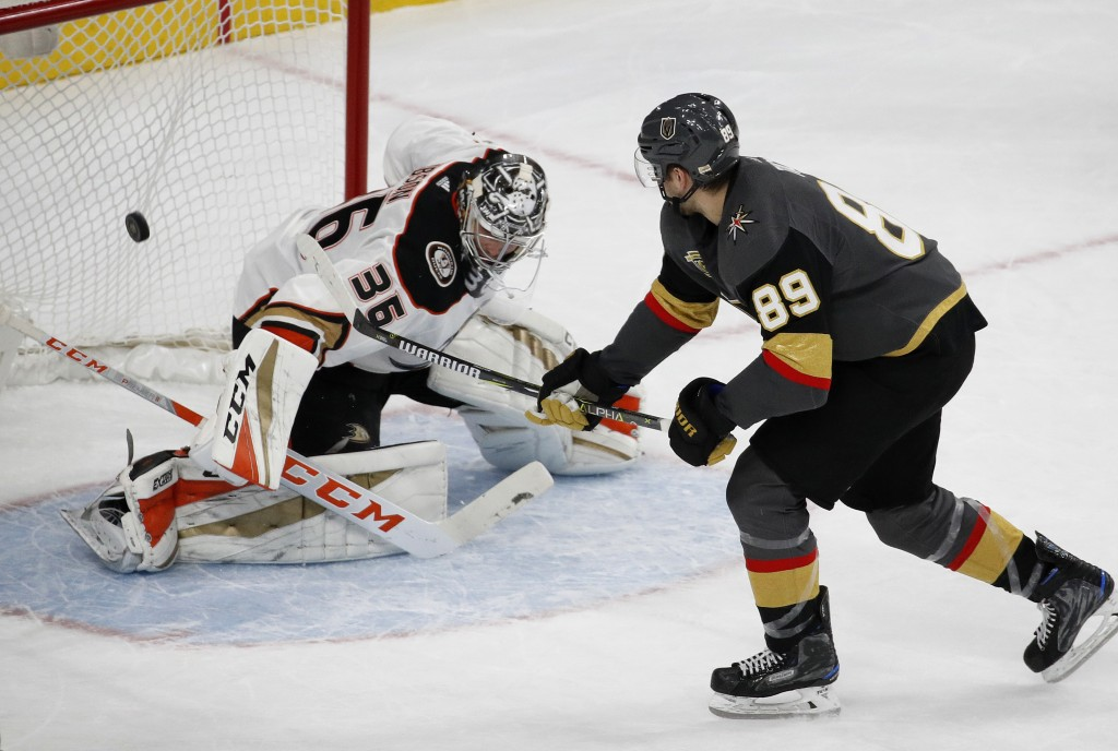 Vegas Golden Knights right wing Alex Tuch scores the only goal of the shootout, against Anaheim Ducks goalie John Gibson in an NHL hockey game Tuesday