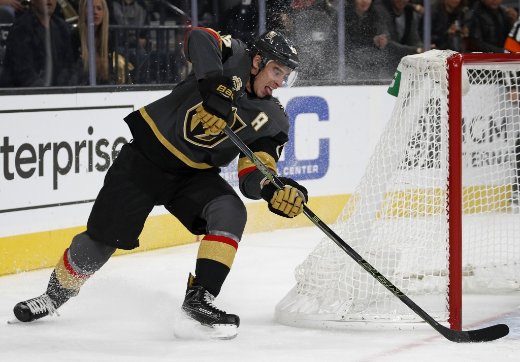 Vegas Golden Knights right wing Reilly Smith attempts a shot against the Anaheim Ducks during the first period of an NHL hockey game Tuesday, Dec. 5,