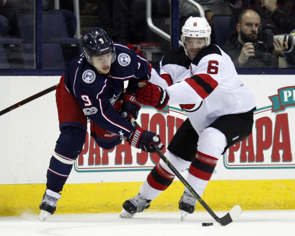 Columbus Blue Jackets forward Artemi Panarin, left, of Russia, tries to pass against New Jersey Devils defenseman Andy Greene during the first period
