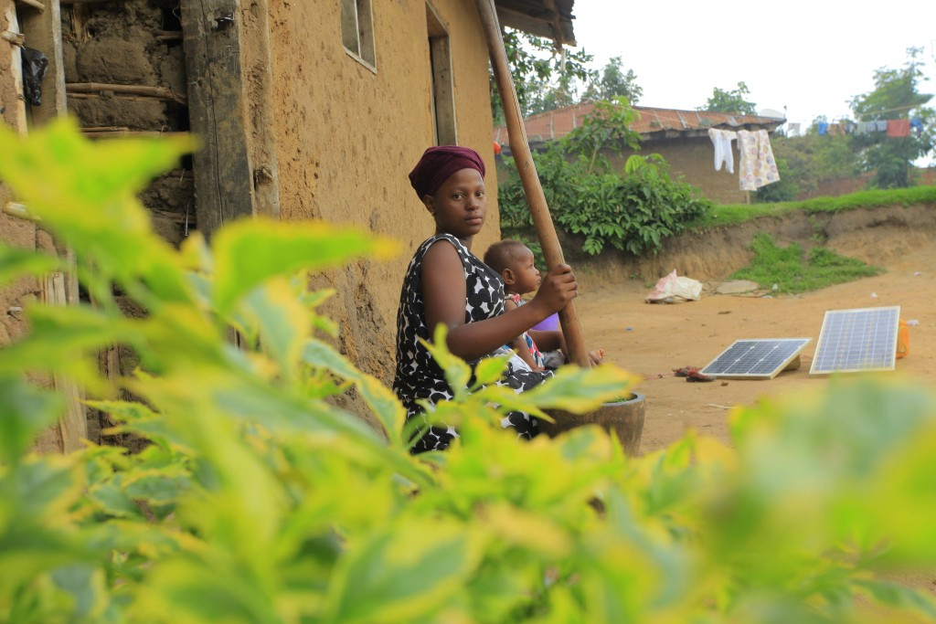 In this photo taken Saturday, Dec. 2, 2017. Faida Mwenge, sits with her son Jospin Kambale, outside her house in Beni eastern Congo. Faida Mwenge's ba